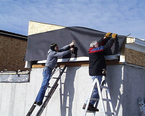 Patrick Wiggins And Boyd Mcneilinstall Tar Paper On The